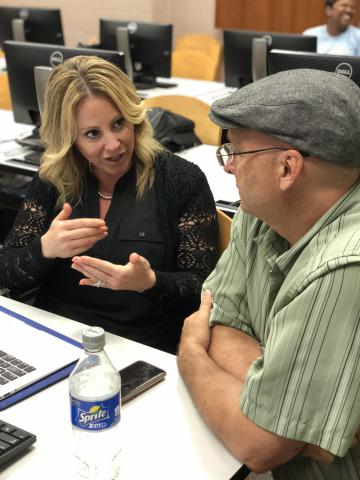 Instructional Designer Carey Hamburg works one-on-one with an instructor at the University of Louisiana at Lafayette.