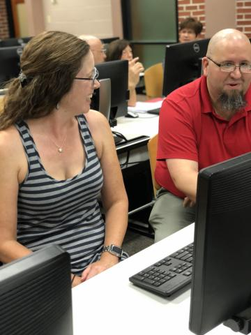 Instructional Technologist Mike Williams works with an instructor during a recent workshop.