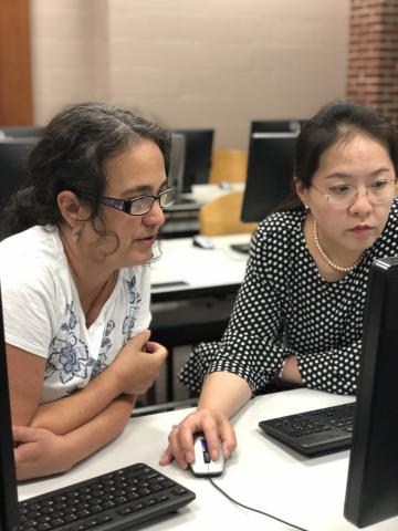 Dr. Diana Wu works with an instructor during a recent workshop at the University of Louisiana at Lafayette Edith Garland Dupre Library.